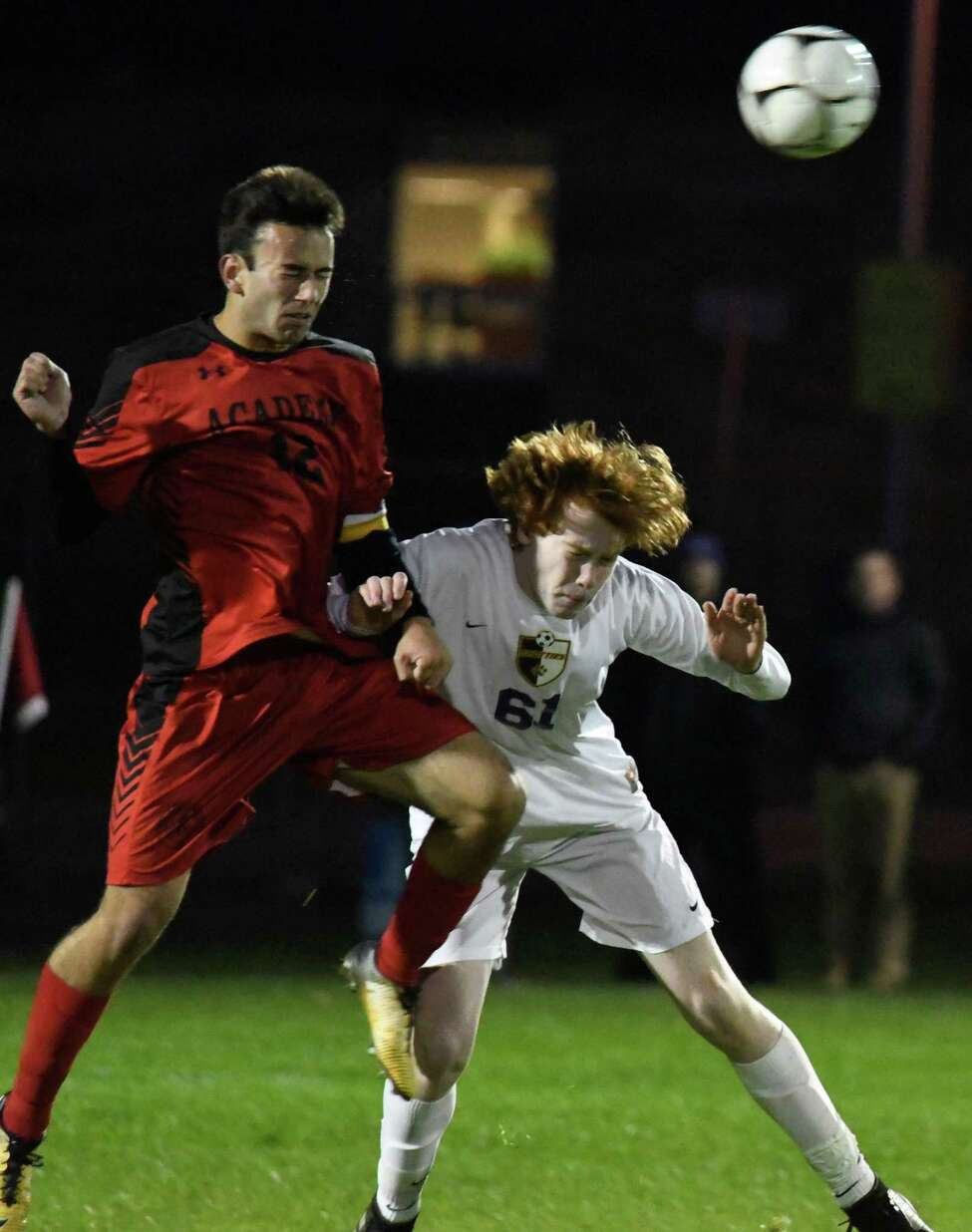 Albany Academy's Thomas Fiebich and Ballston Spa's Justin Waters jump to head the ball during their Class A sectional semifinal at South Colonie High School on Wednesday, Oct. 24, 2018, in Colonie, N.Y. (Jenn March, Special to the Times Union)