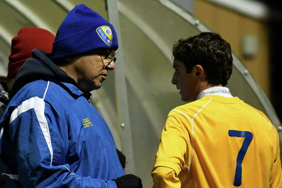 Queensbury head coach Pete Crotty speaks with his player, Teddy Borgos, at halftime during the Class A sectional semifinal against South Glens Falls at South Colonie High School on Wednesday, Oct. 24, 2018, in Colonie, N.Y. (Jenn March, Special to the Times Union) Photo: Jenn March / © Jenn March 2018 © Albany Times Union 2018