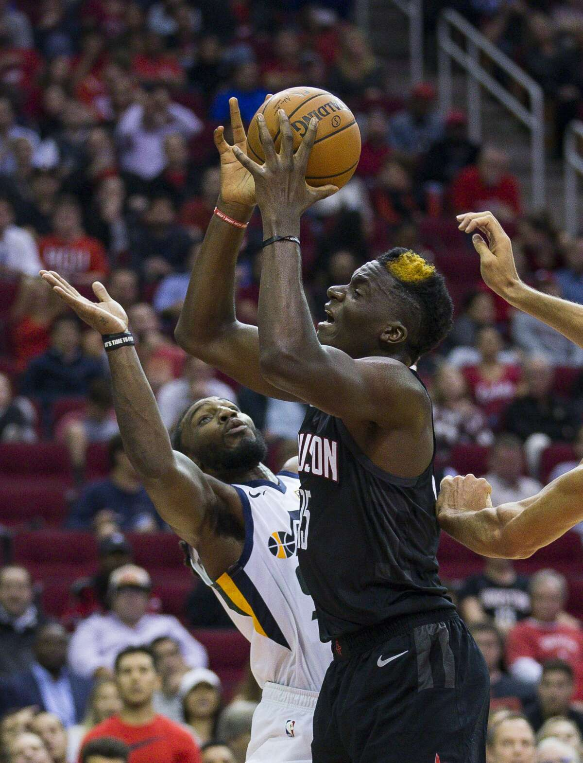 Houston Rockets center Clint Capela (15) is defended by Utah Jazz forward Jae Crowder (99) during the second half of an NBA basketball game between the Houston Rockets and Utah Jazz, Wednesday, Oct. 24, 2018 in Houston.