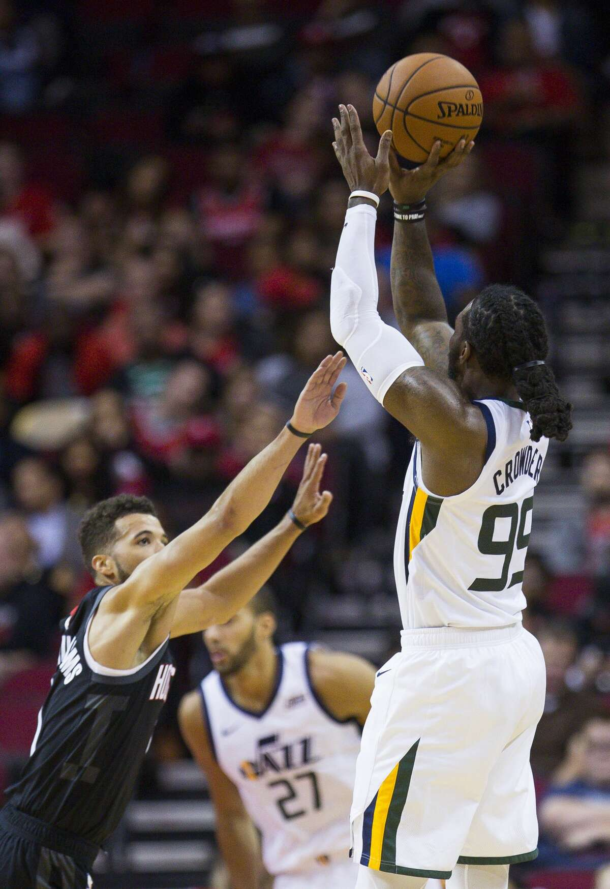 Utah Jazz forward Jae Crowder (99) shoots over Houston Rockets guard Michael Carter-Williams (1) during the second half of an NBA basketball game between the Houston Rockets and Utah Jazz, Wednesday, Oct. 24, 2018 in Houston.