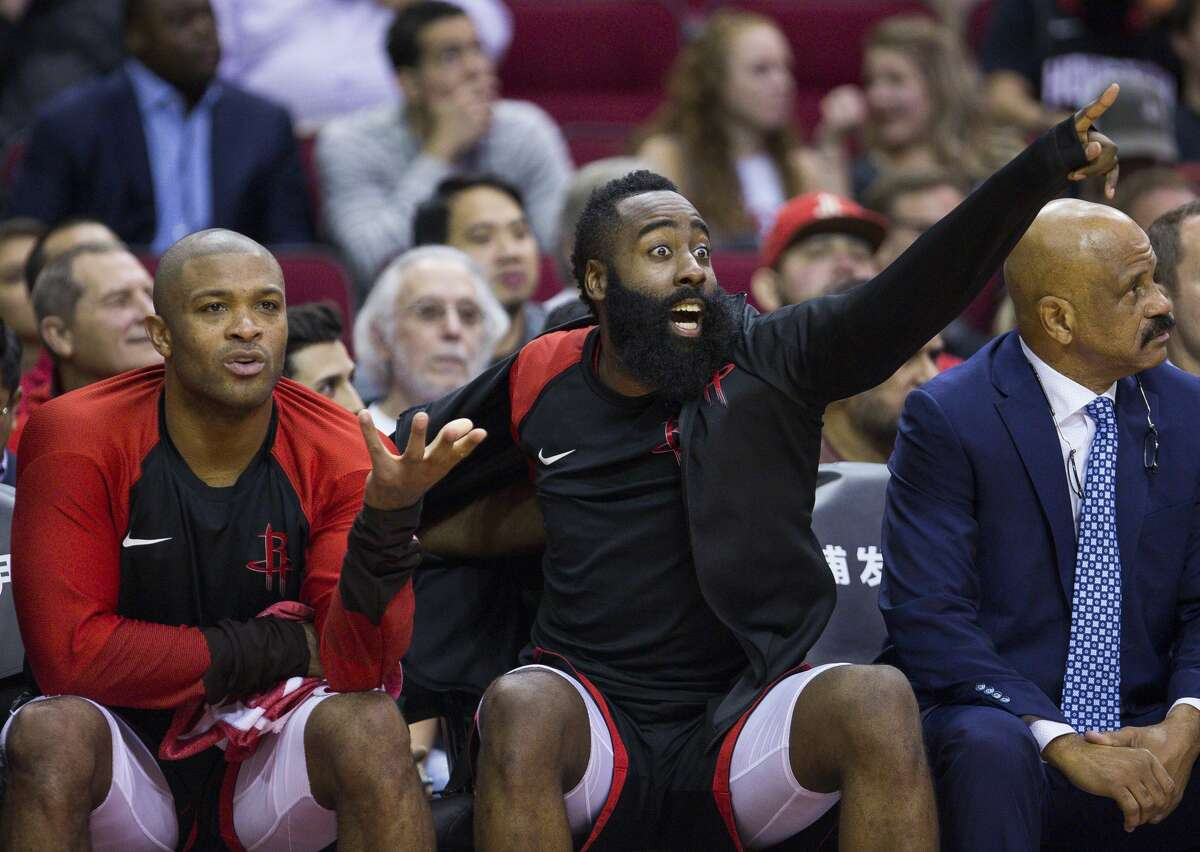 Houston Rockets forward PJ Tucker (17) and guard James Harden (13) react from the bench during the second half of an NBA basketball game between the Houston Rockets and Utah Jazz, Wednesday, Oct. 24, 2018 in Houston.