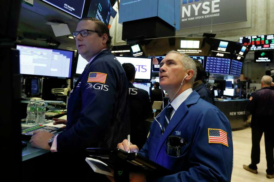 Stocks rose in early trading on Wall Street as the market seemed to breathe a sigh of relief that there was no longer any uncertainty over the midterm elections. (AP Photo/Richard Drew)  NEXT: See most recent earnings reports for Houston energy companies.  Photo: Richard Drew / Copyright 2018 The Associated Press. All rights reserved