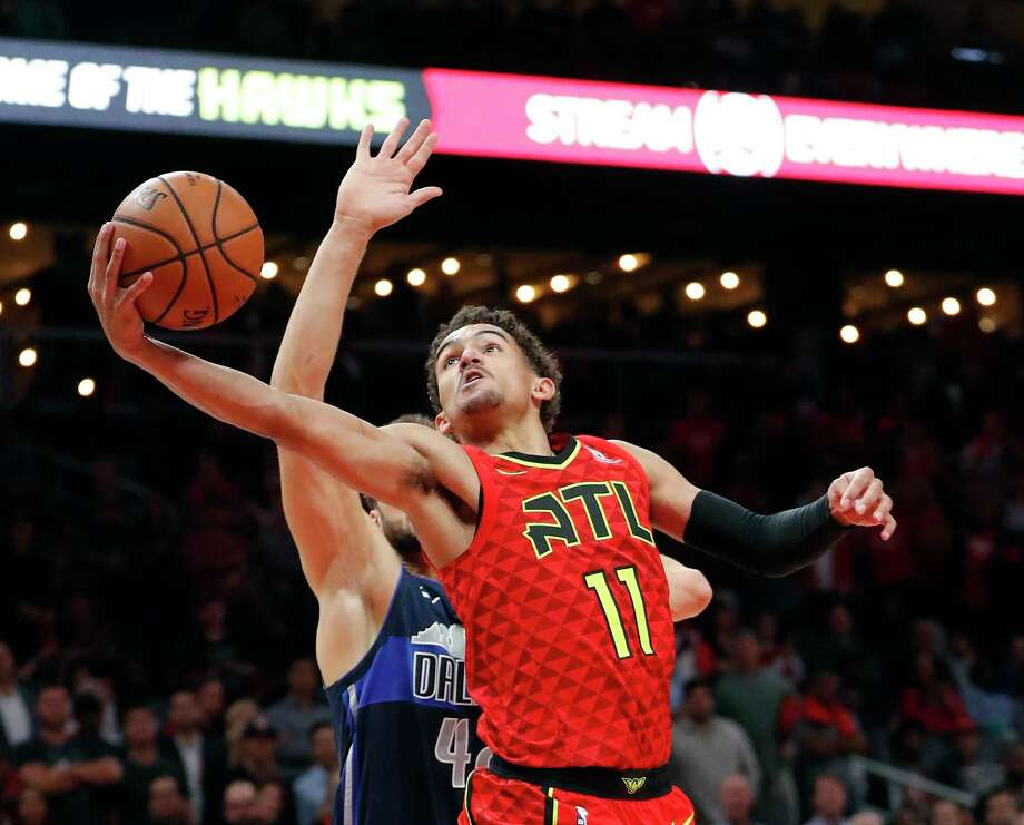 Atlanta Hawks guard Trae Young (11) goes in for basket as Dallas Mavericks  forward 9793fdf70