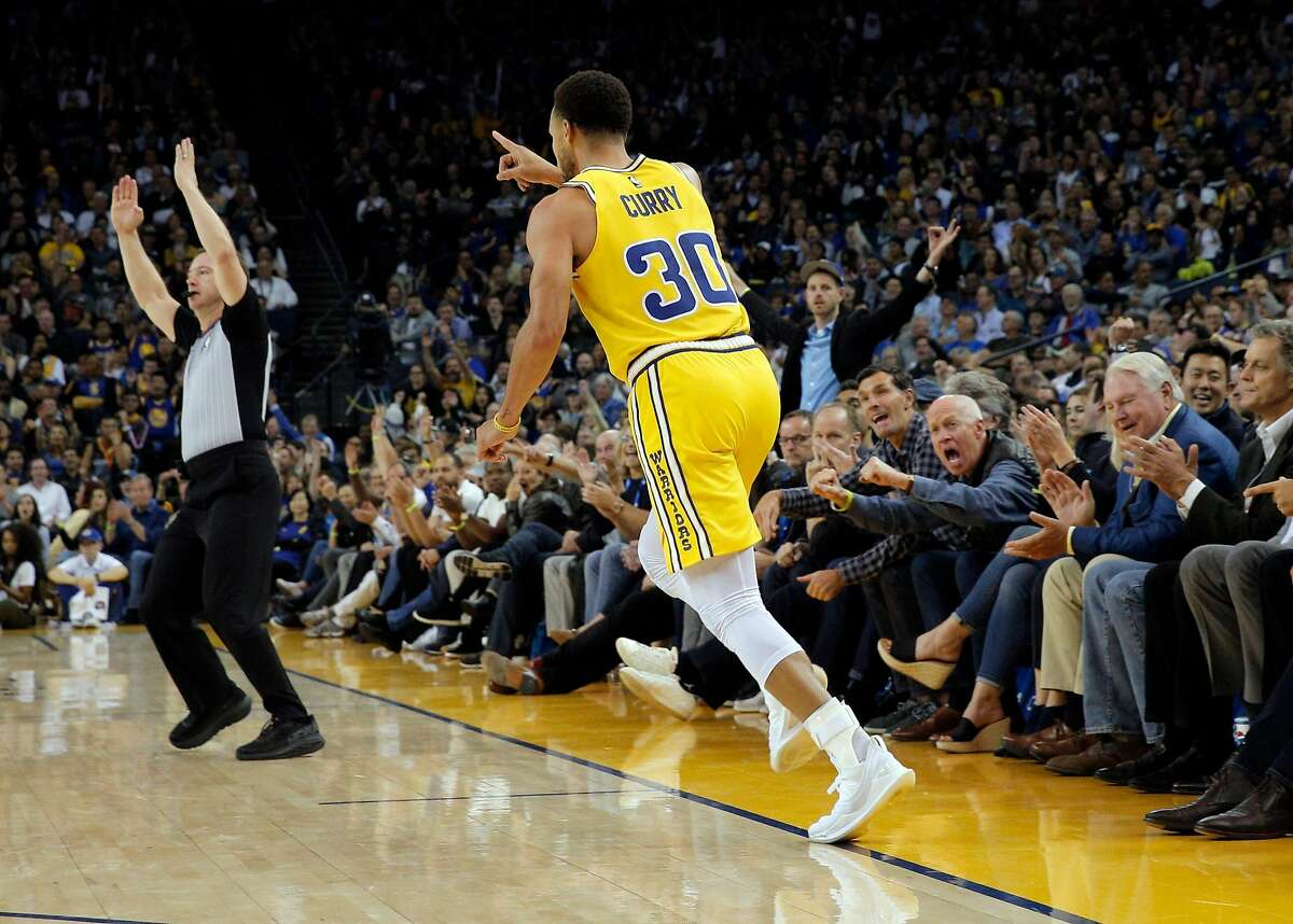Stephen Curry (30) reacts after hitting a three point shot in the second quarter as the Golden State Warriors played the Washington Wizards at Oracle Arena in Oakland, Calif., on Wednesday, October 24, 2018.