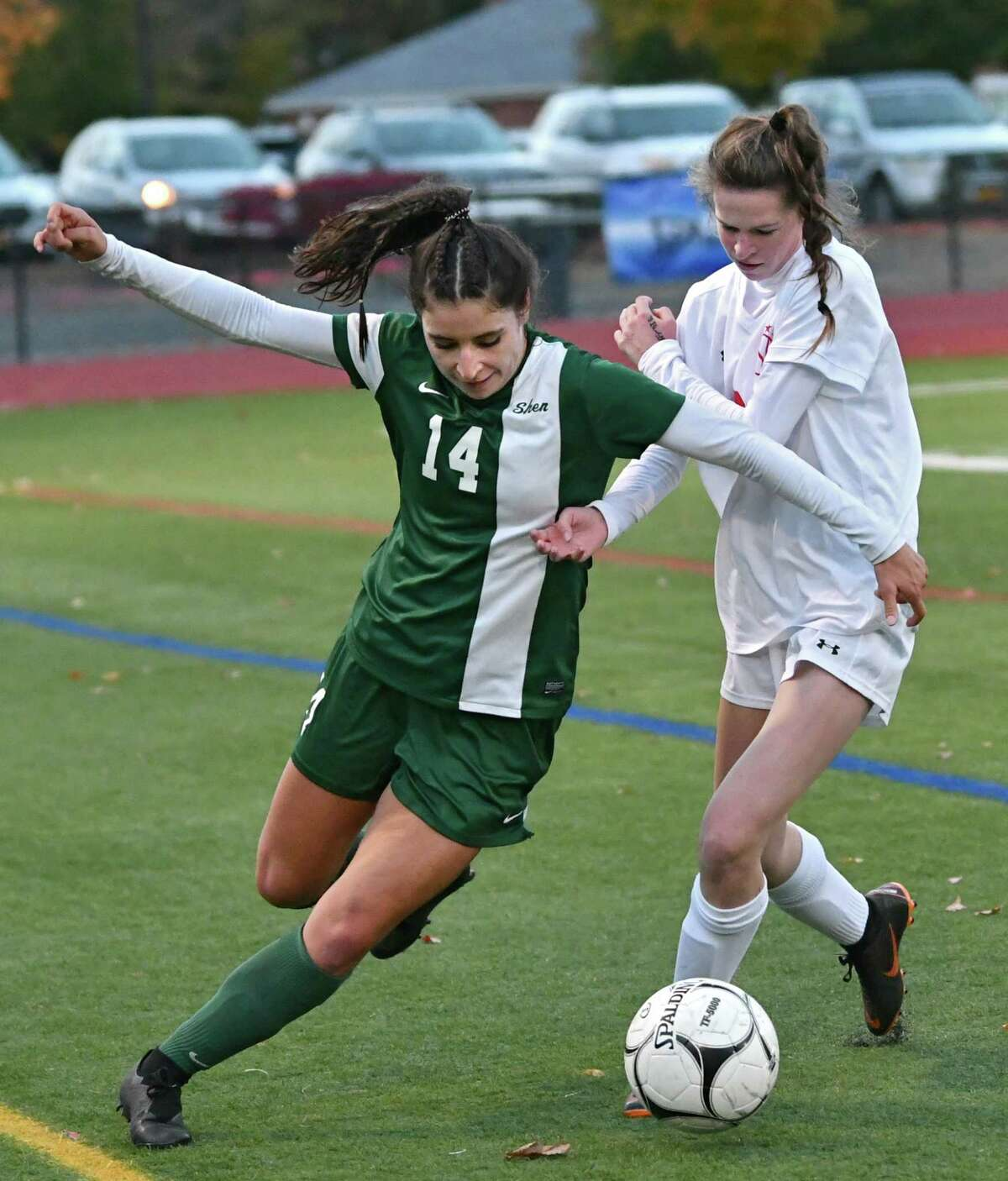 Shenendehowa's Michelle Clarkin, left, battles for the ball with Niskayuna's Lindsay Matthews during the Class AA girls' soccer semifinals on Wednesday, Oct. 24, 2018 in Stillwater, N.Y. (Lori Van Buren/Times Union)