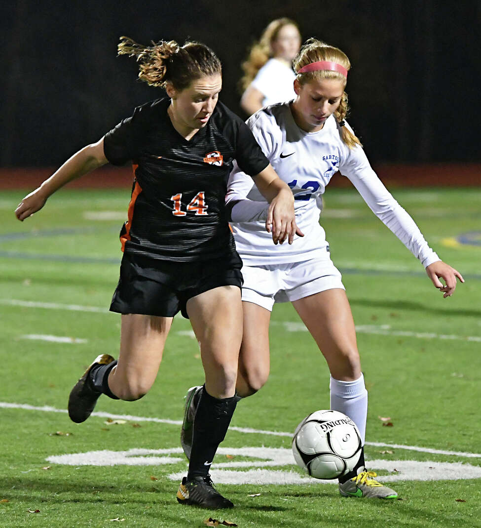 Bethlehem's Grace Hotaling, #14 left, battles for the ball with Saratoga's Autumn Soukup during the Class AA girls' soccer semifinals on Wednesday, Oct. 24, 2018 in Stillwater, N.Y. (Lori Van Buren/Times Union)