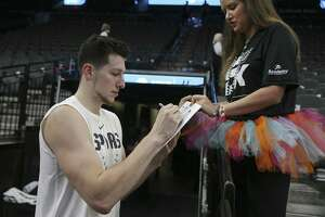 San Antonio Spurs' Drew Eubanks signs an autograph for Chelsea Cook, 24, before their game against the Indiana Pacers at the AT&T Center, Wednesday, Oct. 24, 2018.