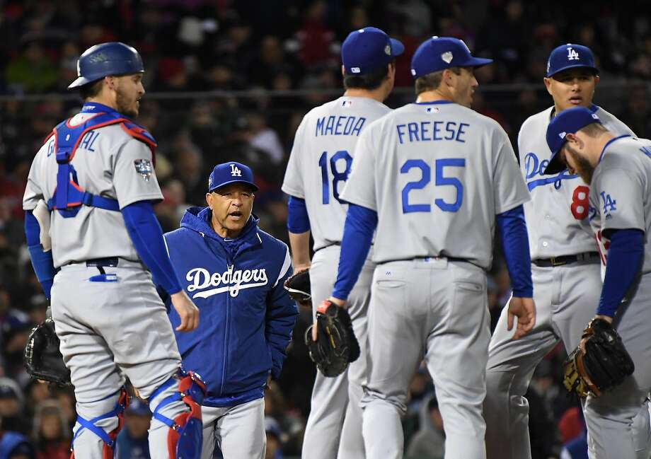 Dodgers manager Dave Roberts heads to the mound to take out reliever Kenta Maeda in the seventh inning. Photo: Wally Skalij / Los Angeles Times