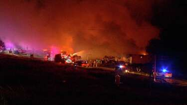 1 killed, 1 injured in fire that destroyed multiple buildings in