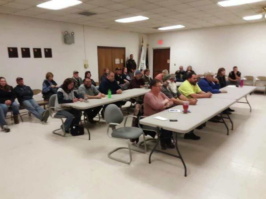 A crowd of people gather Tuesday evening at Mills Township Hall to learn about the possible misuse of township funds. (John Kennett/jkennett)