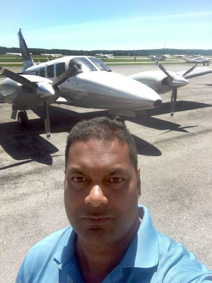 "Authorities have identified 41-year-old Munidat ""Raj"" Persaud of Waterbury as the owner and pilot of the Piper twin turbo prop airplane that crashed into the water about three miles southeast of Francis S. Gabreski Airport in Westhampton Beach, N.Y. Saturday afternoon. Photo: Facebook Image / Hearst Connecticut Media / The News-Times Contributed"