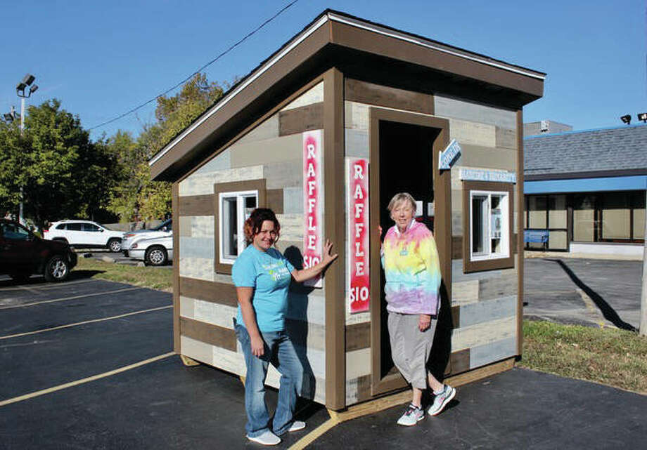 Paula Duane, Habitat For Humanity, and Kay Gieszelmann, Annie's Frozen Custards, check out the playhouse now at Annie's, 245 S. Buchanan St. Edwardsville. The Habitat For Humanity playhouse is being raffled off to raise funds for future builds. Tickets are available at Annie's or online at rafflecreator.com/pages/25224/building-communityliterally. Tickets are $10 for one or $25 for 3. Drawing will be on December 15. Photo: For The Intelligencer