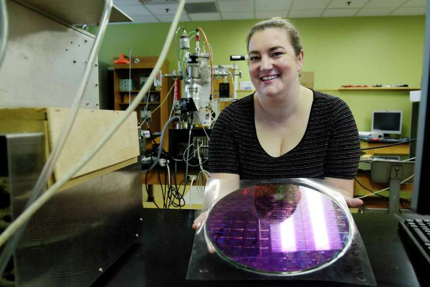 Tania Cabrera, dean of math, science, technology and health at SUNY Schenectady, holds a 300mm silicon wafer in the nanotechnology lab at the college on Thursday, Sept. 6, 2018, in Schenectady, N.Y. (Paul Buckowski/Times Union)