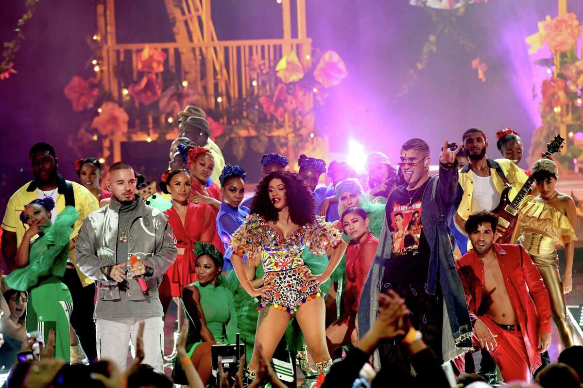 """Cardi B performs """"I Like It"""" on the American Music Awards with reggaeton stars J Balvin (left) and Bad Bunny."""