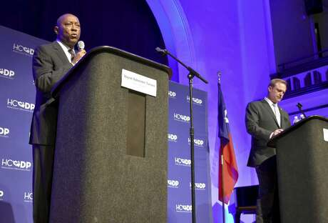 In this Saturday, Oct. 6, 2018 photo, Mayor Sylvester Turner, left, and Houston Professional Fire Firefighters Association President Marty Lancton debate Proposition B, the November ballot referendum that would grant firefighters pay 'parity' with police officers of corresponding rank and seniority, at St. John's United Methodist Church in Houston. (Jasper Scherer/Houston Chronicle via AP)