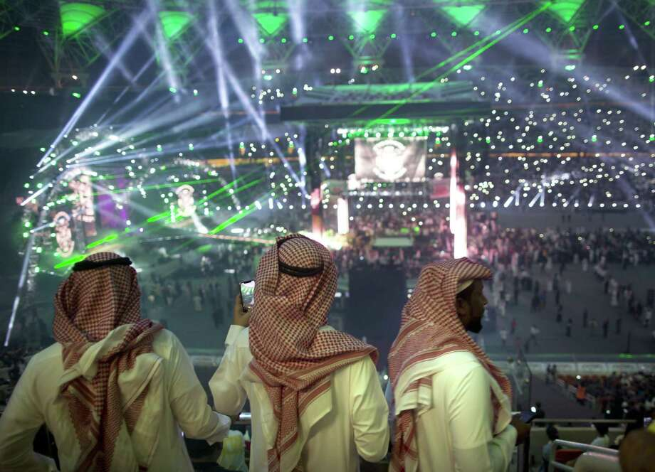 "Fans film the opening of WWE's ""Greatest Royal Rumble"" event in Jeddah, Saudi Arabia, on April 27, 2018. Photo: Amr Nabil / Associated Press / Copyright 2018 The Associated Press. All rights reserved."