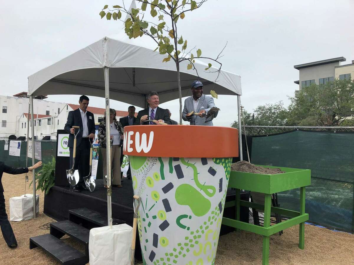 Harris County Judge Ed Emmett and Houston City Council Member Dwight Boykins celebrate recenter's future building at 3809 Main by throwing dirt on to a redbud tree that will be planted at Fannin and Alabama. The new building is slated to open in fall 2019 and will provide housing for 62 recovering addicts and offer community space for programs.