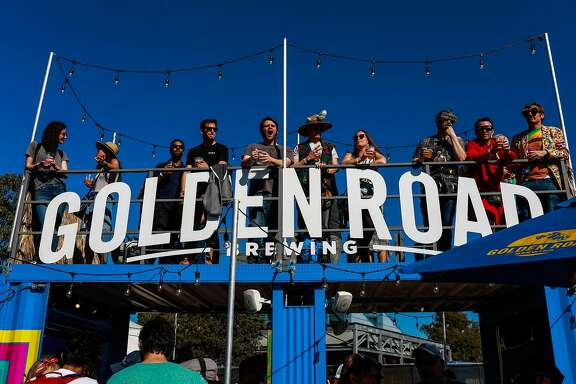 People stand out on the rood of the Golden Road brewing company at the Treasure Island Music Festival in Oakland, California, on Sunday, October 14th, 2018.