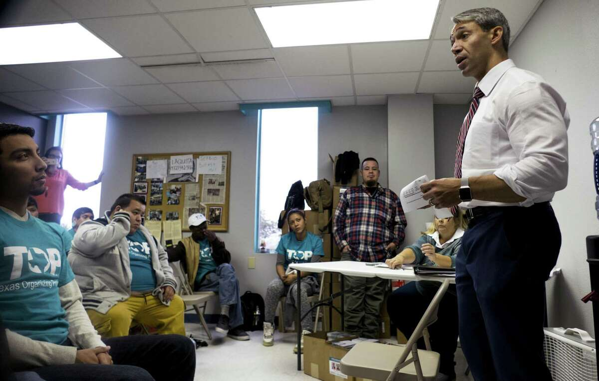 Mayor Ron Nirenberg speaks with Jeremiah Lopez, left, and other members of the Texas Organizing Project before they block walk to inform voters about city charter amendments in October. The powerful community activist organization has endorsed Nirenberg in the June 8 mayoral runoff and has been out in San Antonio neighborhoods talking with voters since Monday.