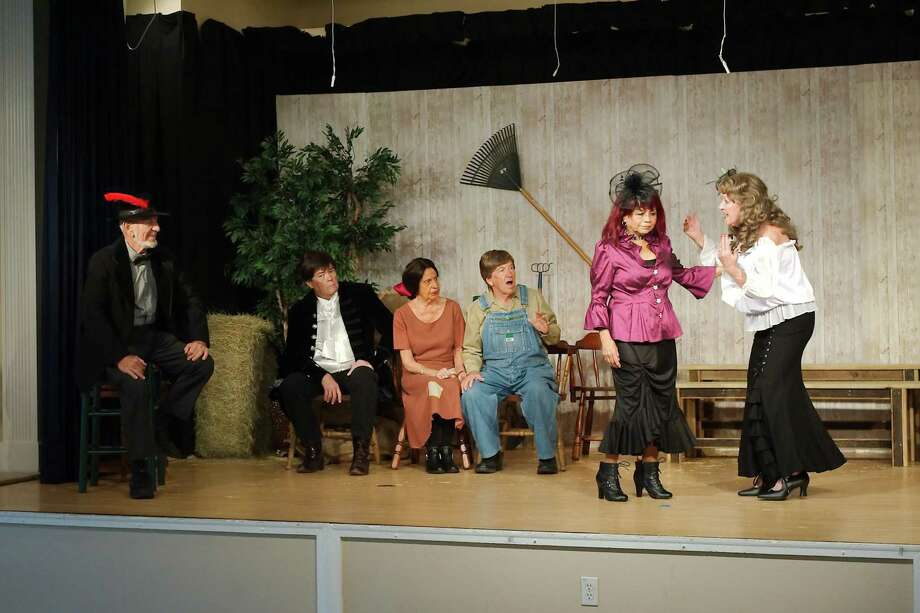 "Characters in ""'The Devil and Daniel Webster"" at the Country Place social hall in Pearland include Blackbeard, Jezebel, Benedict Arnold and other villains from the past who are summoned to serve on a jury to determine the fate of a farmer's soul. Performers include Ben Smusz, left, Terry Fisher, Dianne Williams, Les Williams, Ann Cisneros, and Eddie Young. Photo: Kirk Sides / Houston Chronicle / © 2018 Kirk Sides / Houston Chronicle"