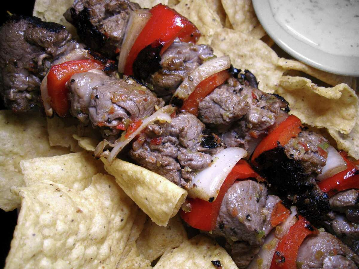 Beef tenderloin anticucho skewers with peppers and onions from Josephine Street Cafe