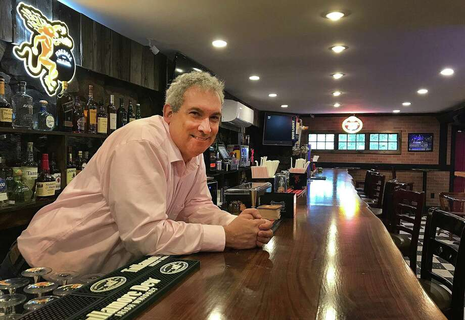Daniel J. Mulvihill Jr., owner of Juddy's Place, stands behind the 40-foot bar at Juddy's in Danbury, Conn., on Wednesday, Oct. 24, 2018. Photo: Chris Bosak / Hearst Connecticut Media / The News-Times