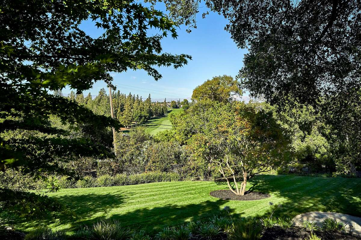 The main home overlooks the first fairway of the Los Altos Golf & Country Club.