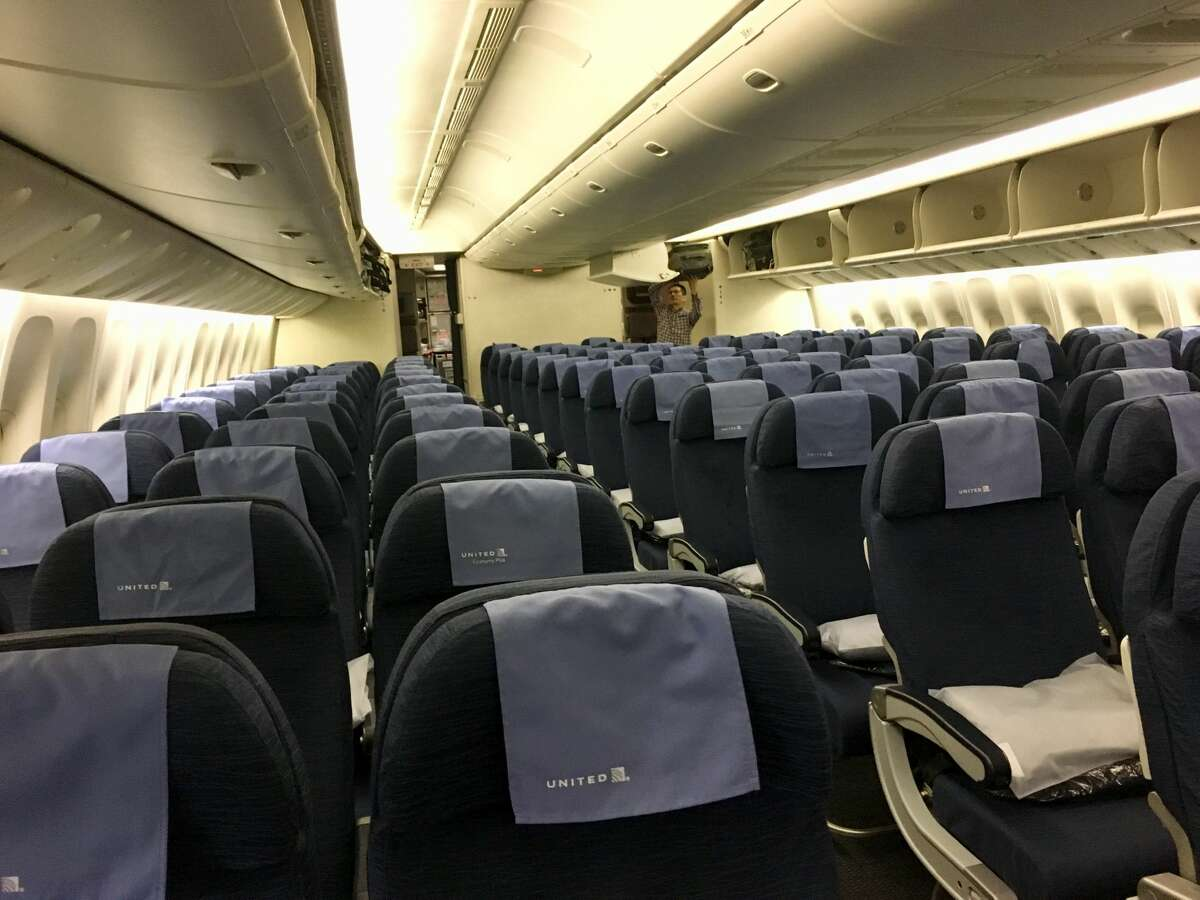 This is the older economy seat on United's Boeing 777-200ER, configured 9-across (3-3-3). It has not been reconfigured into the new layout of 3-4-3 across.