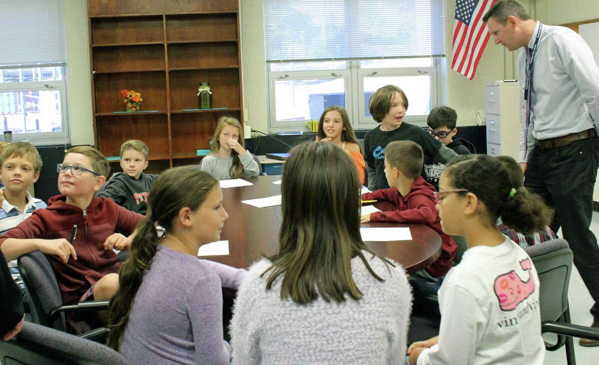 Gregg Pugliese, director of Socials Studies for the town's public schools, guides a group of students at Jennings School through a workshop on strategic planning for Fairfield. Fairfield,CT. 10/23/18