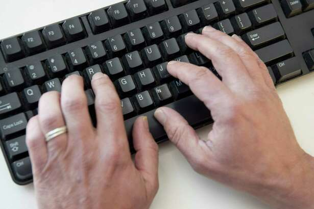 "(FILES) In this file photo taken on November 21, 2016 a man types on a computer keyboard in this photo illustration taken in Washington, DC. - An elite group of North Korean hackers has been identified as the source of a wave of cyberattacks on global banks that has netted ""hundreds of millions"" of dollars, security researchers said on October 3, 2018. A report by the cybersecurity firm FireEye said the newly identified group dubbed APT38 is distinct from but linked to other North Korean hacking operations, and has the mission of raising funds for the isolated Pyongyang regime. (Photo by SAUL LOEB / AFP)SAUL LOEB/AFP/Getty Images"