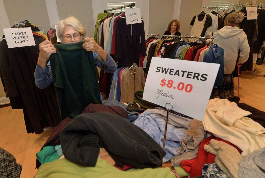 Sarah Sakissian shops at The Westport Womans Club annual Clothing Tag Sale Friday, October 19, 2018, at the club, 44 Imperial Ave., in Westport, Conn. The sale features new and gently used womens, mens and childrens clothing and accessories. Proceeds support student scholarships and local charities. The sale continues Sunday from noon until 3pm. Photo: Erik Trautmann / Hearst Connecticut Media / Norwalk Hour
