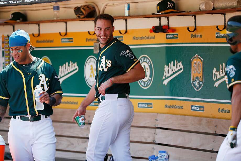 Oakland Athletics first baseman Matt Olson (28) after scoring smiles in the dugout during an MLB game between the Oakland Athletics and Houston Astros at the OaklandÐAlameda County Coliseum on Saturday, Aug. 18, 2018, in Oakland, Calif. Photo: Santiago Mejia / The Chronicle