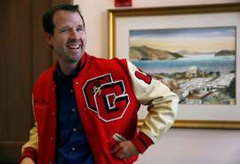 Brandon Mercer wears the letterman's jacket he earned as a student athlete in 1993 from Glendale High School in San Francisco, Calif. on Wednesday, Oct. 24, 2018.