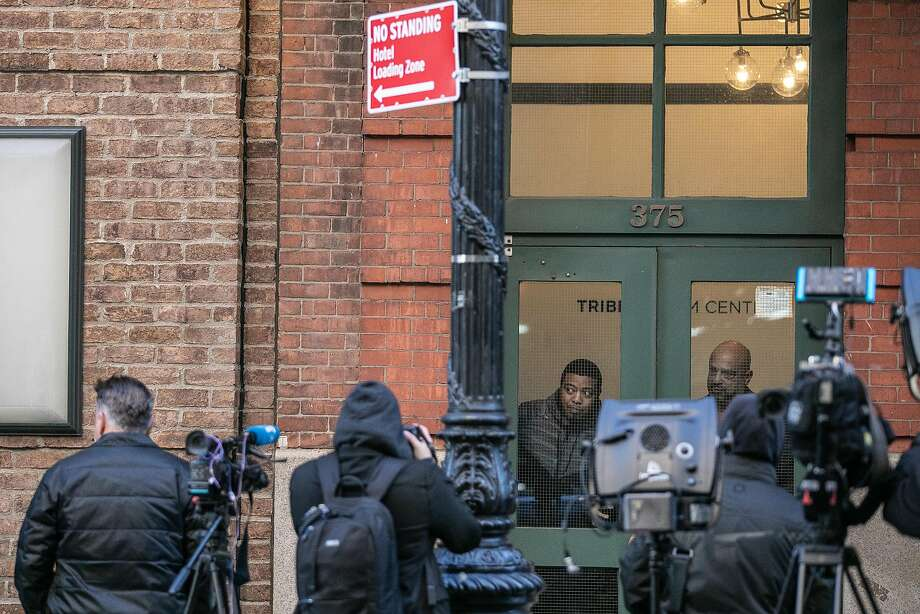 Reporters gather outside the Tribeca Film Center, where a package with a pipe bomb was sent to actor Robert De Niro. Photo: Jeenah Moon / New York Times