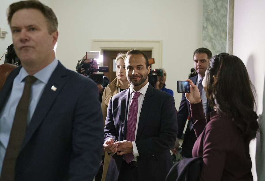 George Papadopoulos (center), the former Trump campaign adviser who triggered the Russia investigation, arrives for his first appearance before two GOP-led House committees. Photo: Carolyn Kaster / Associated Press