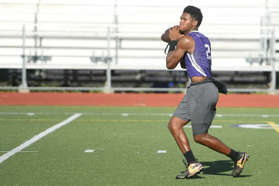 Port Neches-Groves quarterback Roschon Johnson looks to pass during a 7-on-7 game against West Brook at Indian Stadium.  Photo taken Tuesday 6/12/18  Ryan Pelham/The Enterprise Photo: Ryan Pelham / The Enterprise / ©2018 The Beaumont Enterprise