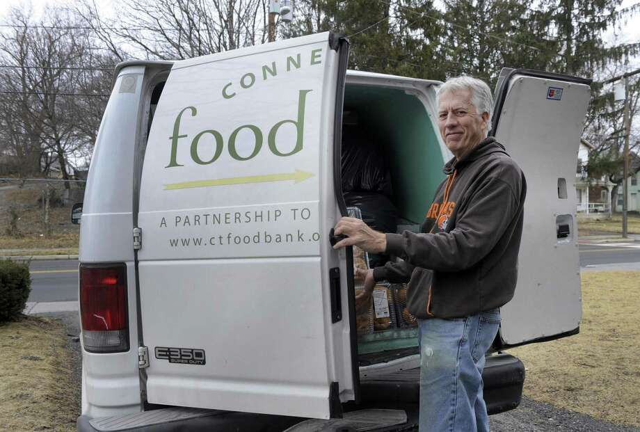 Mike Greene delivers food from local grocery stores to the Jericho Partnership Food Pantry on Spring Street, Friday, Feb. 16, 2018. Photo: Carol Kaliff / Hearst Connecticut Media / The News-Times