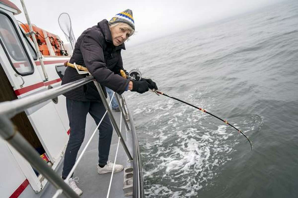 Capt. Jacqueline Douglas of the Wacky Jacky fishing boat reels her line in.