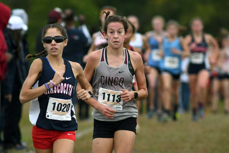 Atascocita sophomore Avery Clover (1020) runs ahead of Cinco Ranch sophomore Sophie Atkinson (1113) during the Division 6A Girls race at the UIL Region III Cross Country Championships at Kate Barr-Ross Park in Huntsville on Oct. 22, 2018. Photo: Jerry Baker, Houston Chronicle / Contributor / Houston Chronicle