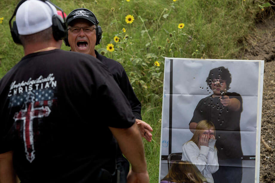 Range manager and head instructor Jaime Correa teaches a Principles of Active Shooter class to members of the church safety response team, including Shane Dahlberg, left, at LoneStar Handgun in Converse. / Lisa Krantz/San Antonio Express-News