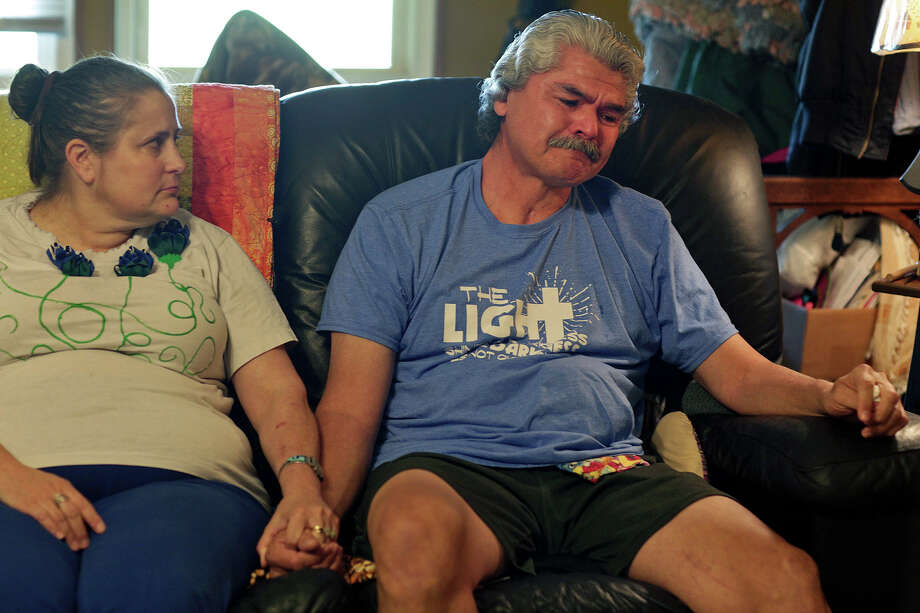 Two months after he returned to the church, Gunny Macias, with his wife, Jennifer, recounts his experience of the shooting. Gunny was shot multiple times. / Lisa Krantz/San Antonio Express-News