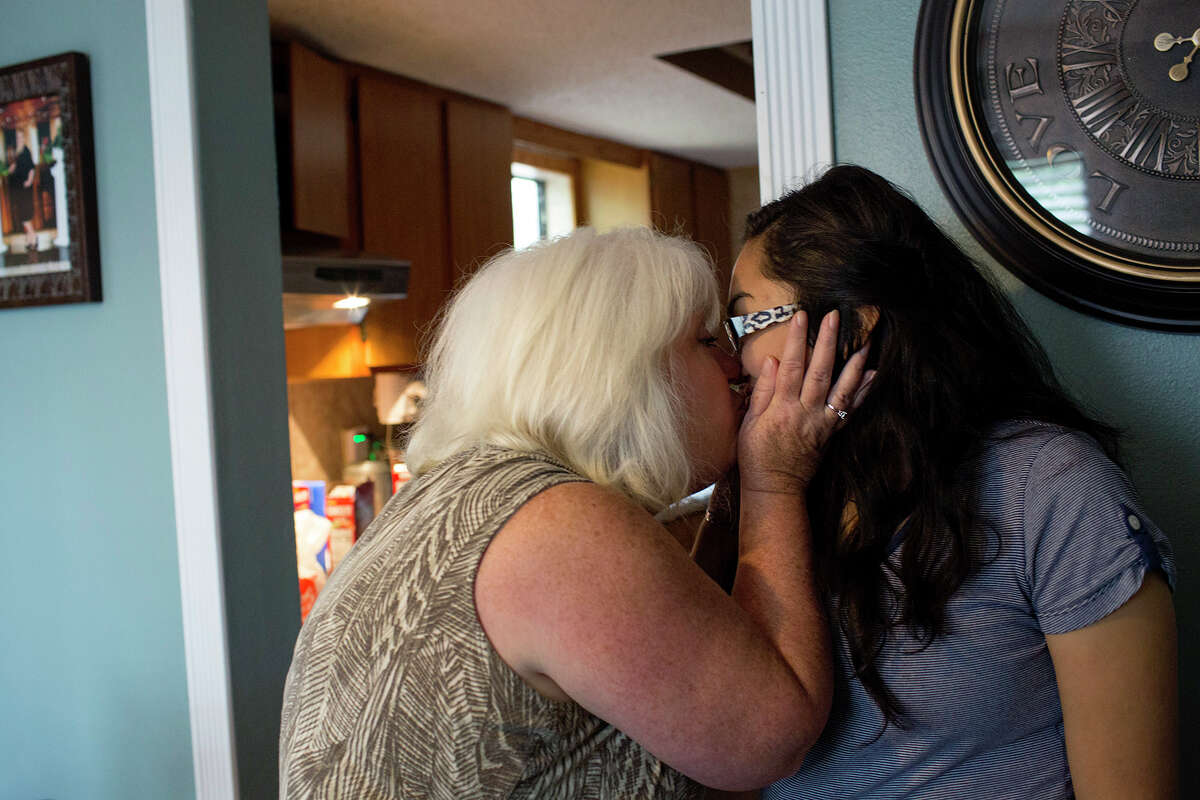Michelle Shields kisses her daughter, Danielle Kelley, on August 6, 2018 at Michelle's home in Sutherland Springs. Danielle is the widow of the gunman who killed Shields' mother and 25 other parishioners at the church Danielle grew up in.
