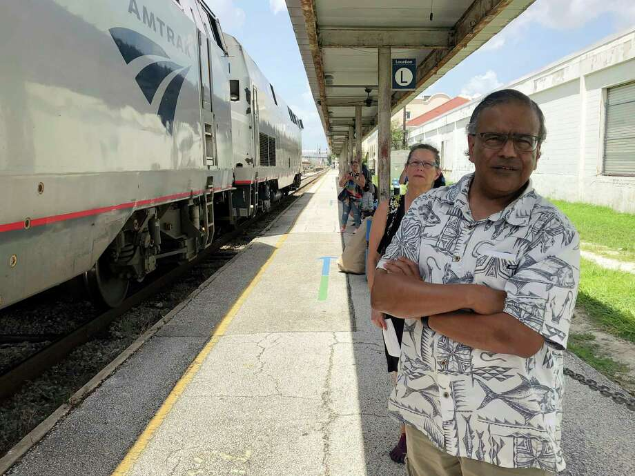 In this Aug. 9, 2018 photo, Jishnu Mukdrji and Penny Jacobs wait to board an Amtrak train in Orlando, Fla. Murkdrji and Jacobs became friends from online train forums that get other rail enthusiasts together for trips around the United States. They were headed to Pennsylvania for a memorial service for one of the members in their train group who died of a heart attack in July while traveling with his train buddies to New Orleans. (AP Photo/Mike Schneider) Photo: Michael Schneider / Copyright 2018 The Associated Press. All rights reserved.
