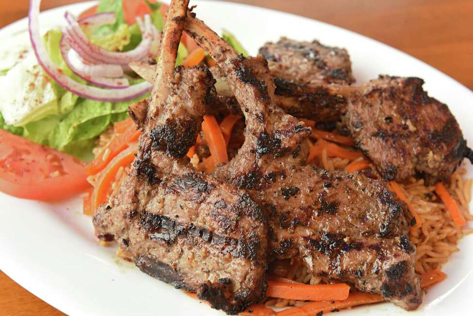 Lamb chops marinated in special seasonings and grilled at Mazadar Mediterranean Kitchen on Wednesday, Oct. 17, 2018 in Colonie, N.Y. (Lori Van Buren/Times Union)