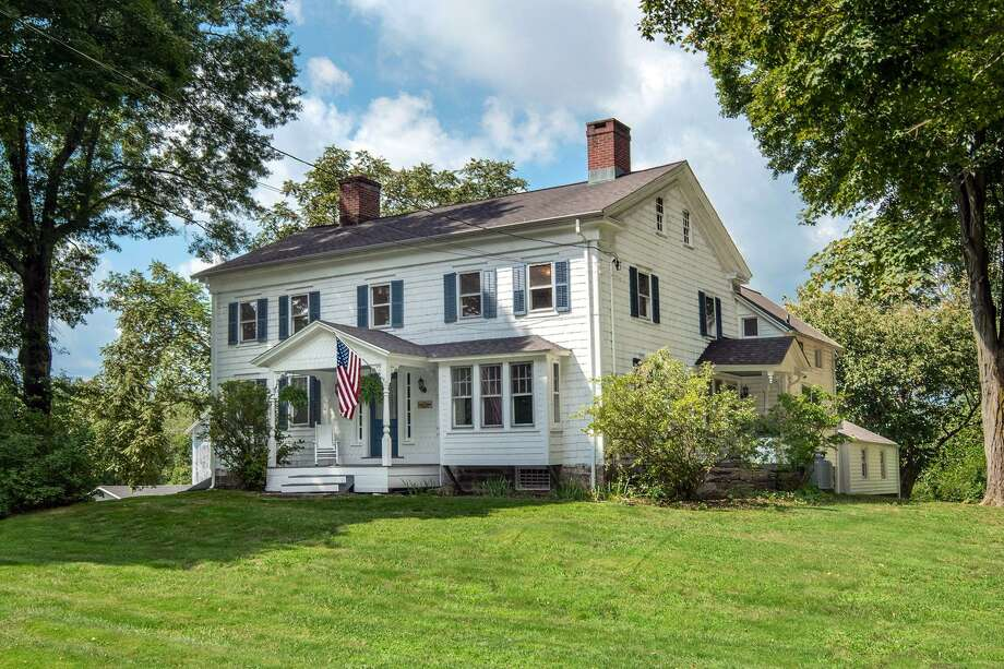 The rustic farmhouse at 125 Church Road in Easton is more than 200 years old, a fact that is evident in the care of its craftsmanship -- which includes wide-plank floors in most rooms and lots of built-in storage. The 2,829-square foot Colonial sits on more than four acres of property, which includes a three story barn ideal for equestrian lovers, as well as a classic family outhouse. The property is bordered by stone walls, and is a true classic of New England architecture. Photo: Contributed Photo / Contributed Photo / Connecticut Post Contributed