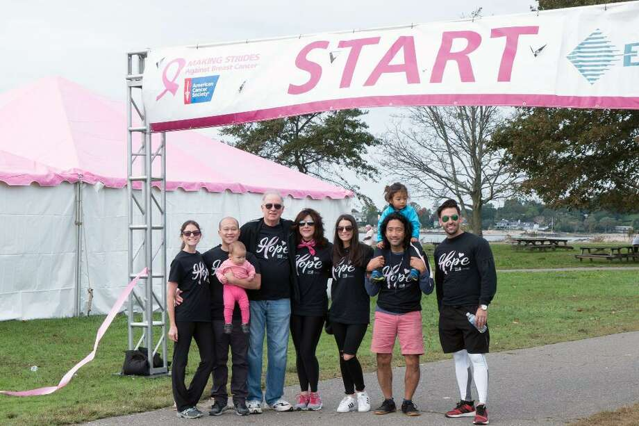 From left, Dr. Yuen-Jong Liu, wife Meredith and son Hao-Zhu; Dr. Fredric Newman and Stacey Clarfield Newman; Larissa Swanson; Dr. Leo Otake with son Elliot, and Gil Lobo walked during Sunday's Making Strides Against Breast Cancer event at Sherwood Island State Park in Westport. Photo: Contributed Photo