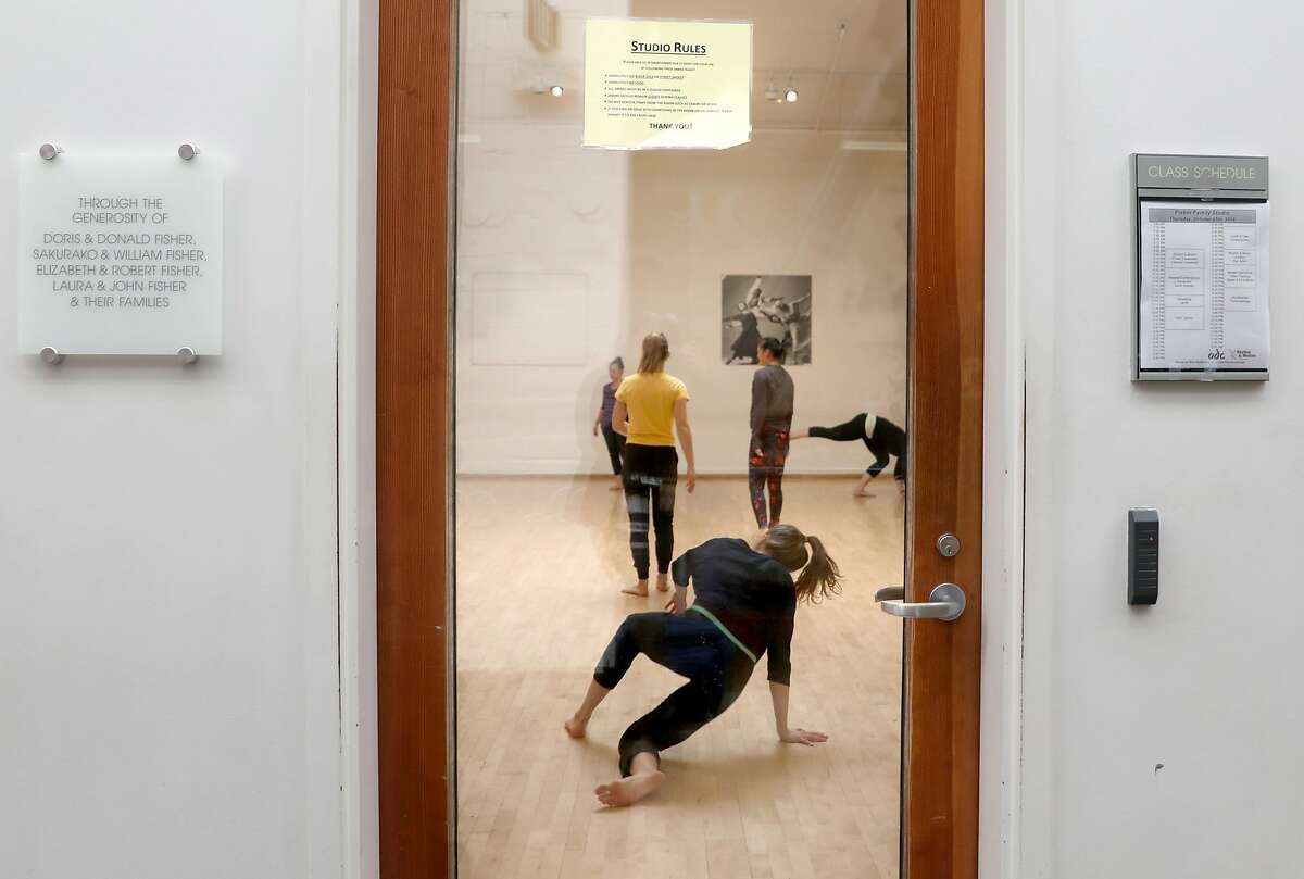 A release/contemporary dance class seen through a door at ODC on Thursday, Oct. 25, 2018 in San Francisco, Calif. Prop E, a measure on the SF ballot would link arts and cultural funding, like ODC, a contemporary dance and arts organization founded in 1971, to the city's hotel tax.