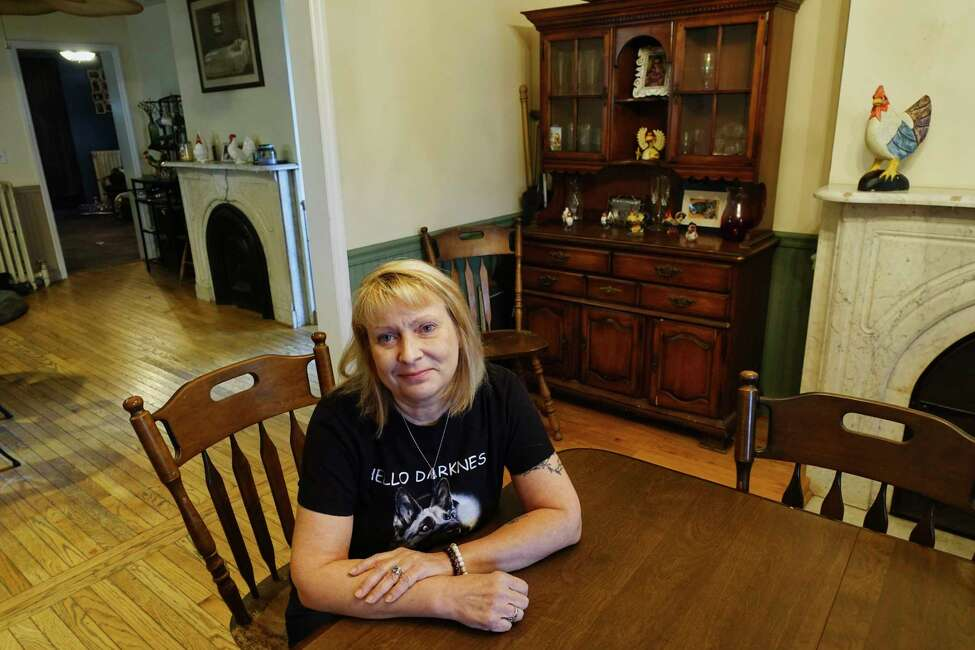 Mindy Connors poses for a photo in the dining room at her home on Wednesday, Oct. 24, 2018, in Watervliet, N.Y. Connors says that the dining room is the place where she and her family members sense the spirit of a grandmother the most in their home. The home,which Connors was born and raised in, was built in 1850. The grandmother, who's spirit they sense was the grandmother of a little boy, Jared, who died in the home of pneumonia. Connors and her family also see and sense the spirit of Jared in the home. (Paul Buckowski/Times Union)