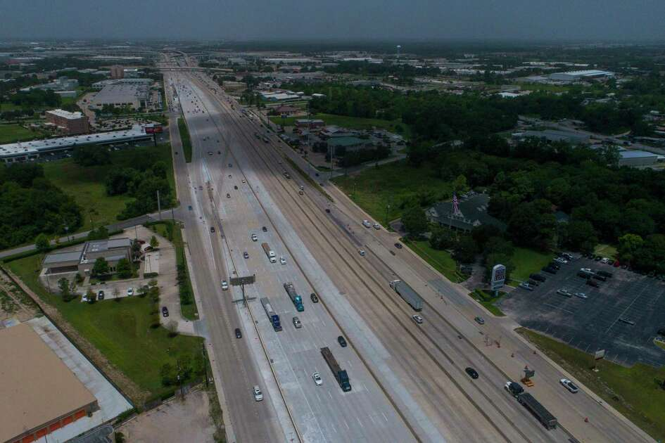 Traffic travels eastbound where new lanes opened on U.S. 290 between Pinemont and W. Little York on July 16.