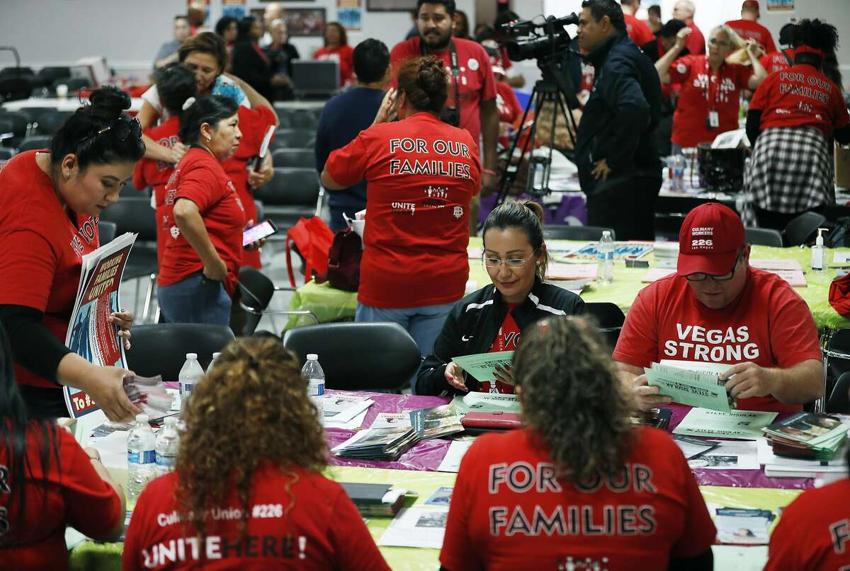 In this Oct. 17, 2018, photo, members of the Culinary Union prepare packets before canvassing for Democratic candidates in Las Vegas. Some Latinos are infuriated by President Trump and eager to vote in the midterms. Some are too demoralized to go to the polls. And some still like the president. (AP Photo/John Locher)